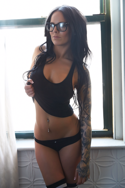 Girl tattoo model with glasses